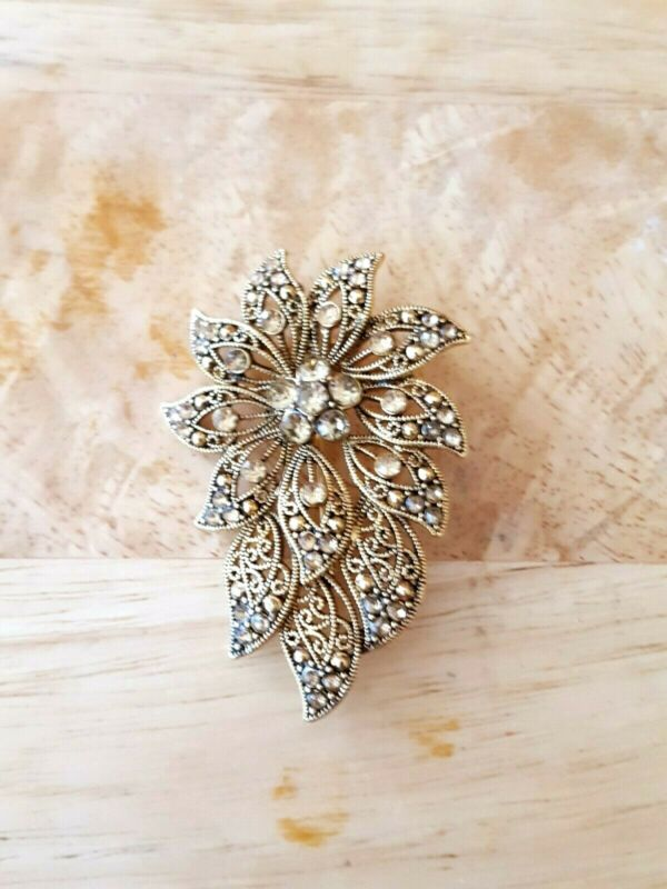 Vintage gold tone rhinestone LC brooch