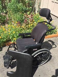 Reclining Wheelchair with Table attachment and ROHO seat cushion