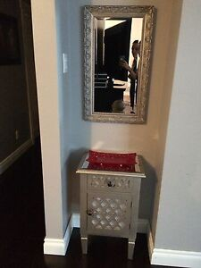 Accent table and decorative mirror