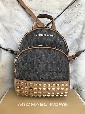 NWT MICHAEL KORS SIGNATURE PVC ABBEY XS STUDDED  BACKPACK BAG IN BROWN/ACORN