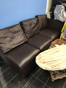 2 Leather Sofas and Stone Table