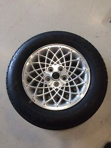 P 225/60R16 tire and rim