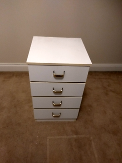 White and gold drawers