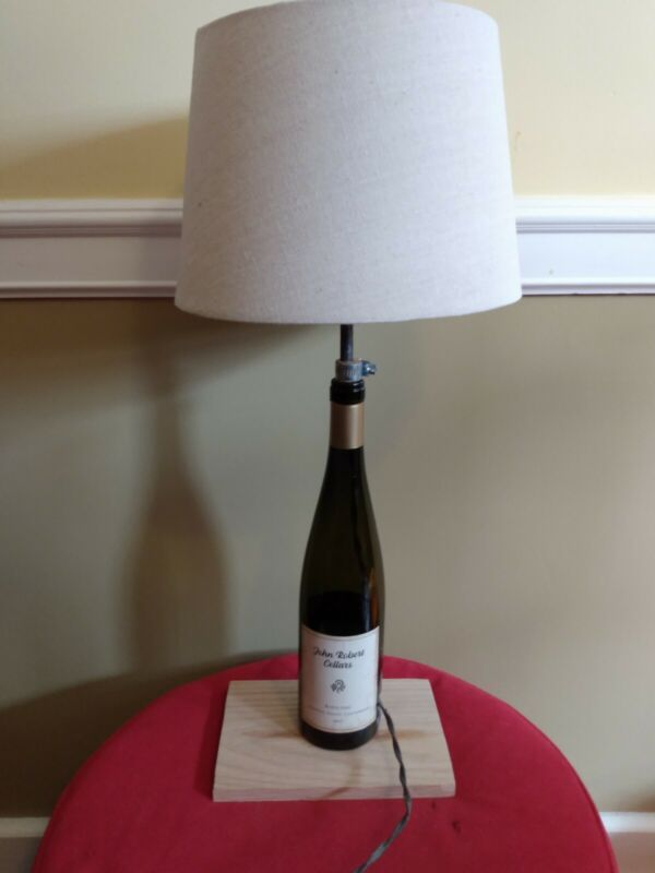 Used furniture for sale by owner. Romantic wine bottle lamp.