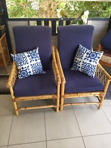 2 matching cane chairs