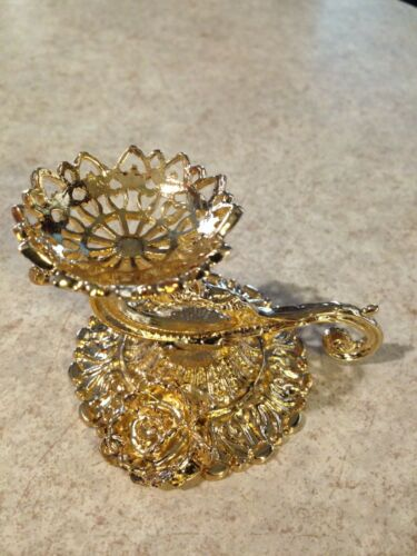 Egg stand, gold tone