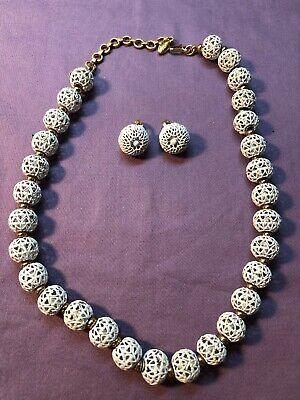 60s -70s Jewelry – Necklaces, Earrings, Rings, Bracelets VINTAGE MONET 1960's WHITE ENAMEL FILIGREE CUT BALL BEAD NECKLACE CLIP EARRINGS $29.99 AT vintagedancer.com