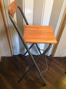 Collapsible raised stool.