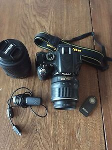 Nikon D5100 with two lenses