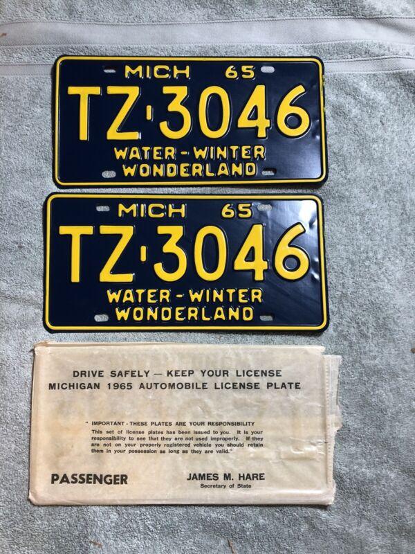 1965 Michigan License Plate Pair TZ-3046 New Old Stock Water Winter Wonderland