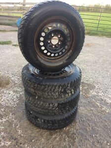 4 Hancook snow tires and rims. 205 / 70 R15