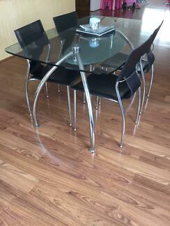 Harvey Norman - Glass Dining table with 6 matching seats Huntingdale Gosnells Area Preview