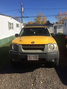 Yellow Nissan Xterra super charged se