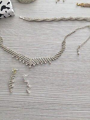 Parure collier ,boucles ,bracelet en strass