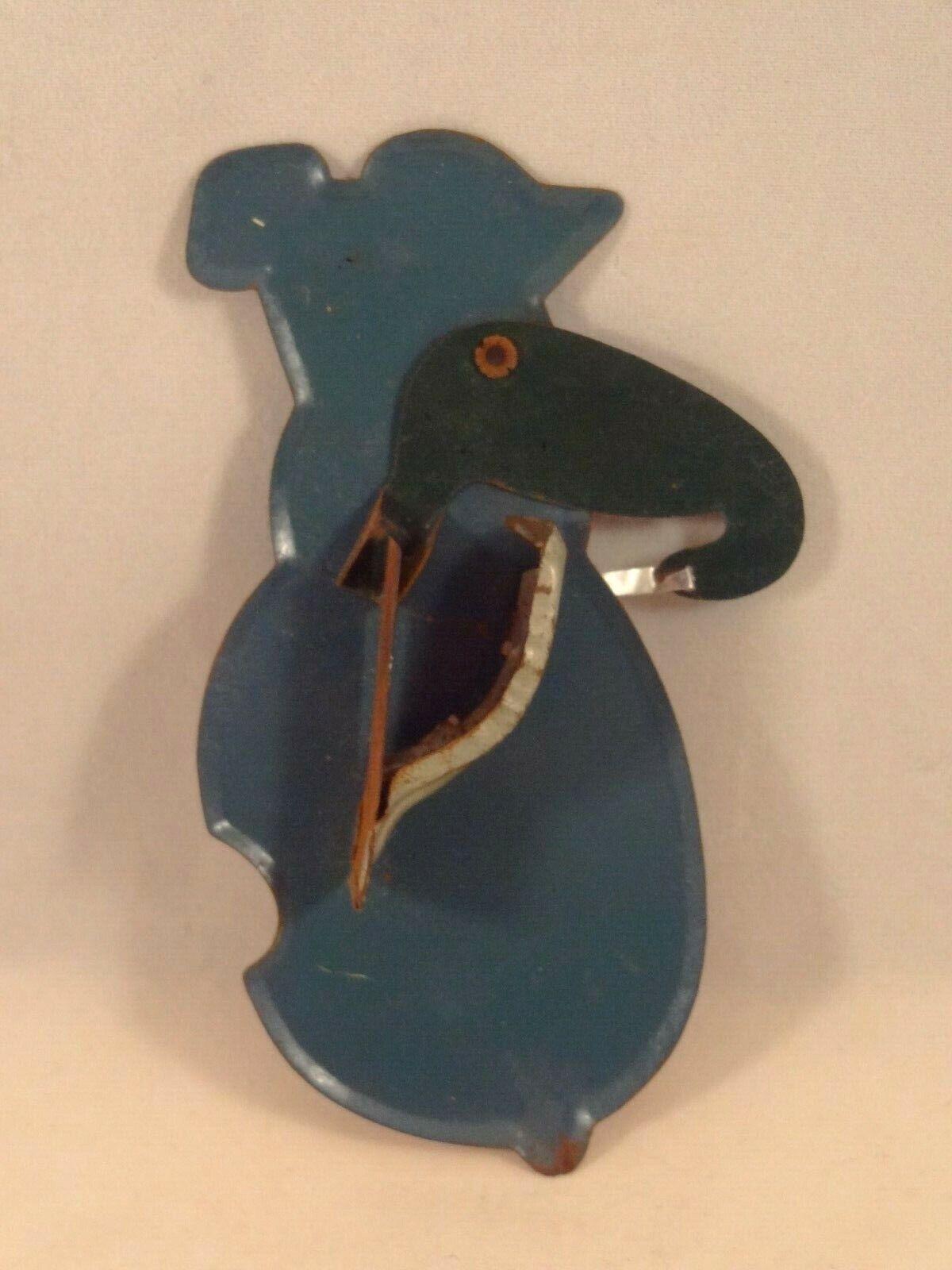 Ancien jouet tôle clic-clac pingouin violoncelliste musicien clicker japan 1950