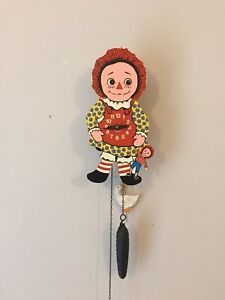 Vintage weight driven girl with moving eyes wall clock