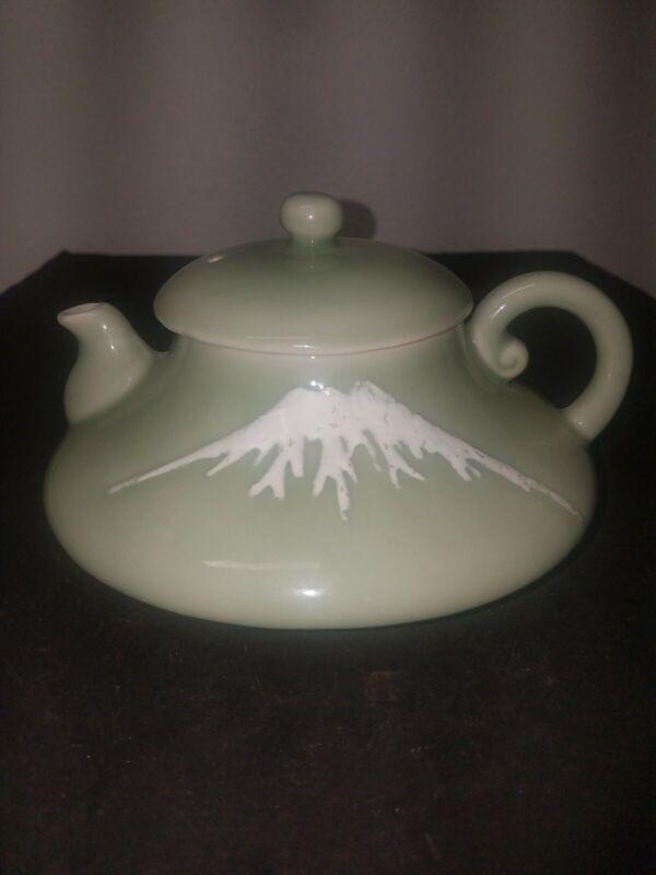 Chinese Celadon glaze teal green Teapot with snow mountain design
