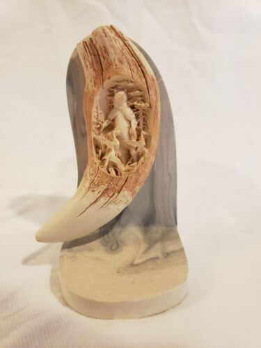 Reproduction Of a Northern Stellar Sea Lion Tooth Carving