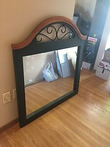 Large decorative mirror with rod iron accent