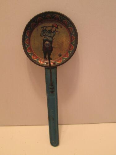 VINTAGE GERMAN METAL TIN NOISEMAKER PIPE SMOKING GOLFER IN KNICKERS HITTING BALL