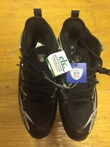 Reebok cleats size 13.5. New.