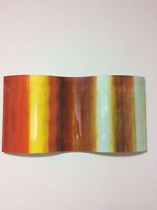 Red and orange glass wall hanging