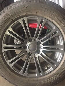 4 Goodyear Ultra grip winter tires and rims