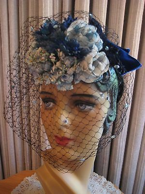 CHARMING 40'S BLUE FLORAL TILT HAT W/CHENILLE DOT VEILING, BACK BOW
