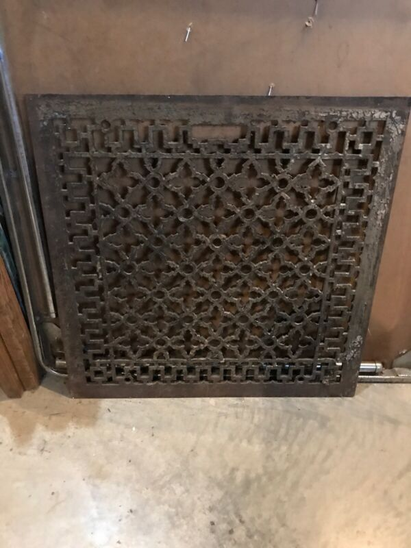 An Antique cast-iron floor or wall heating grate 22.25 x 22.5