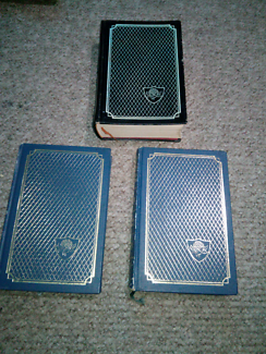 Hard cover books x 3