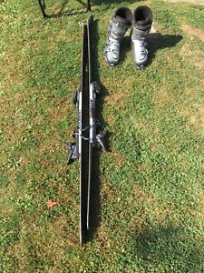 Atomic downhill skis 180 and boots 28.0