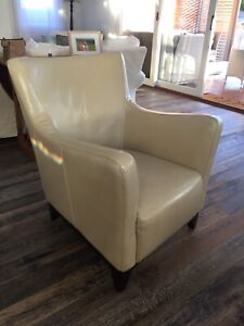 2 leather look armchairs