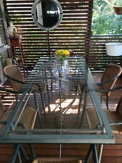 Solid glass topped dining table