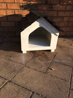 Small outdoor wooden dog or cat house