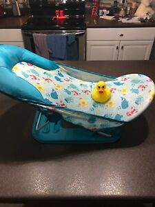 Baby bath chair and rubber ducky thermometer