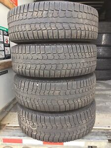 p215/65/16 inch Winter Tires on Volkswagon Rims / GOOD DEAL
