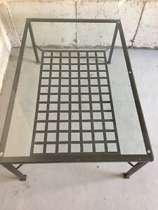 Glass coffee table with metal frame
