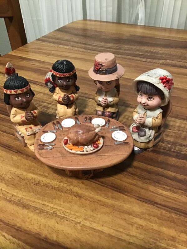 THANKSGIVING PILGRIMS AND INDIANS PRAYING AROUND DINNER TABLE. CERAMIC