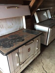 Two Antique Wood Burning Stoves