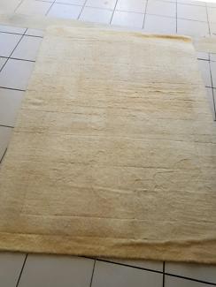 Cream wool rug cleaned & sanitised