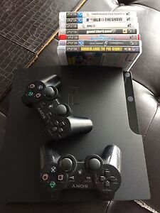 PS3  console , 2 controllers, games