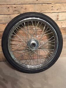 "21""front wheel - NEW chrome spoked wheel with new Avon tire."