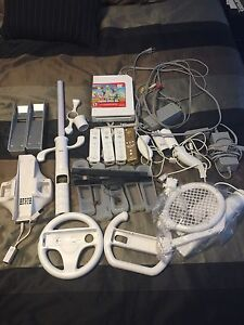 Nintendo Wii with 7 games and accessories.