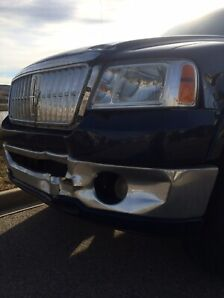 Lincoln Mark truck. Front end damage