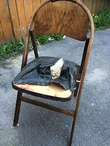 Really old vintage folding chair in need of TLC.