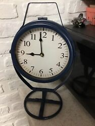 Battery Operated Clock On Blue Metal Pedestal