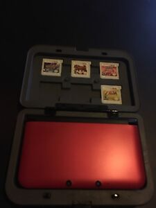 $220$ MINT condition 3DS XL with 5 games