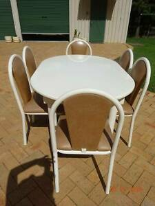 White Oval Extendable Table with Six Chairs