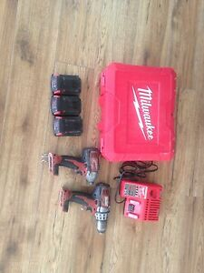 MILUAKEE M18 DRILL SET WITH IMPACT CHARGER AND 3 BATTERIES
