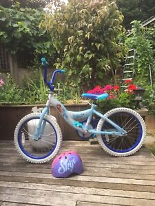 Frozen bicycle for sale with paw patrol helmet